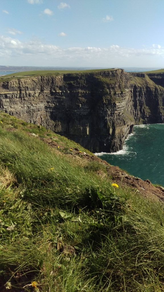 Featured Travel blog Midlife Milestones picture of a cliff and ocean.